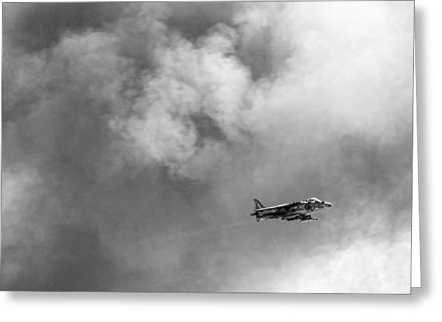 Air Shows Greeting Cards - AV-8B Harrier flies through the smoke of war Greeting Card by Peter Tellone