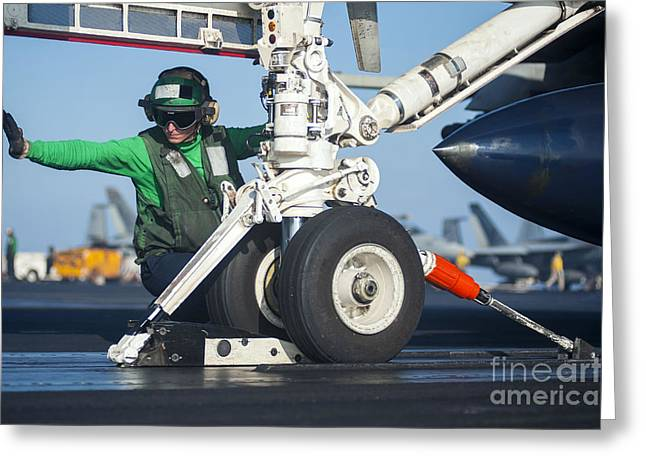Military Airplanes Greeting Cards - Aviation Boatswains Mate Attaches An Greeting Card by Stocktrek Images