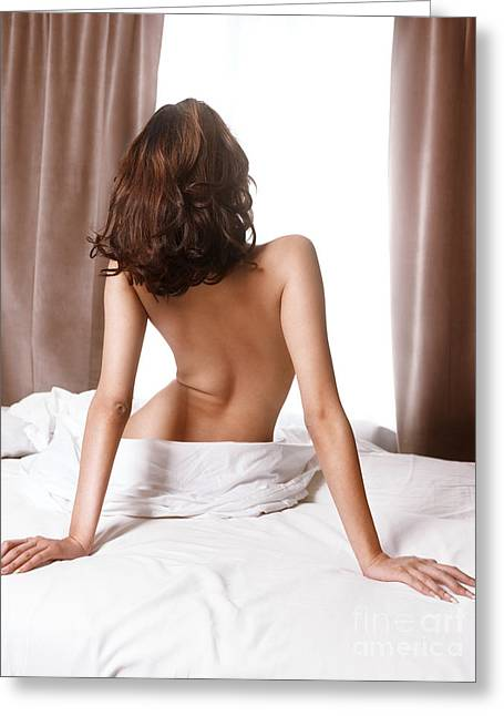 Healthy Sexuality Greeting Cards - Back of woman sitting naked on bed in front of window Greeting Card by Oleksiy Maksymenko