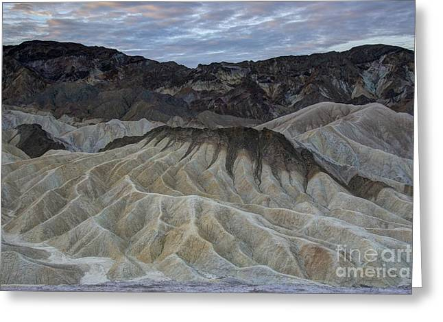 Landforms Greeting Cards - Badlands at Sunrise. Death Valley Greeting Card by Juli Scalzi