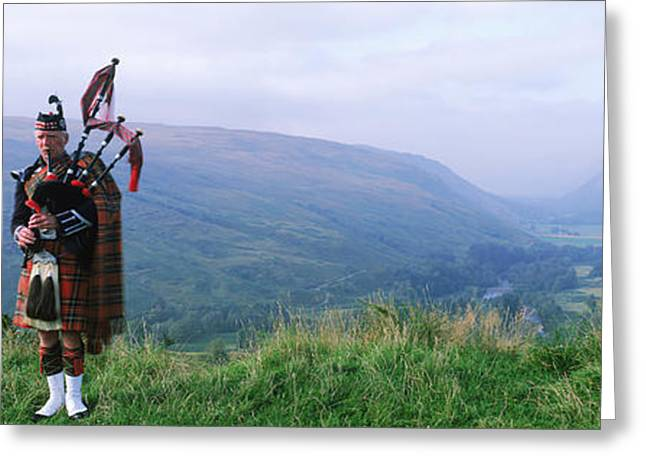 Music Photography Greeting Cards - Bagpiper At Loch Broom In Scottish Greeting Card by Panoramic Images