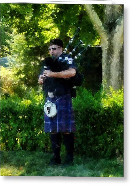 Instruments Greeting Cards - Bagpiper Greeting Card by Susan Savad