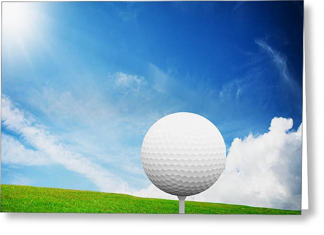 Golf Photographs Greeting Cards - Ball on tee on green golf field Greeting Card by Michal Bednarek