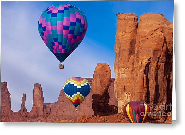 Three Hot Air Balloons Greeting Cards - Balloon festival in Monument Valley Greeting Card by Brian Jannsen