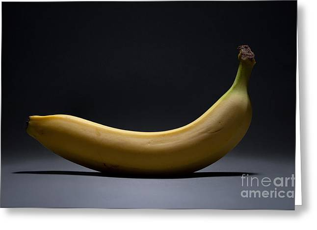 Fruits Photographs Greeting Cards - Banana In Limbo Greeting Card by Dan Holm