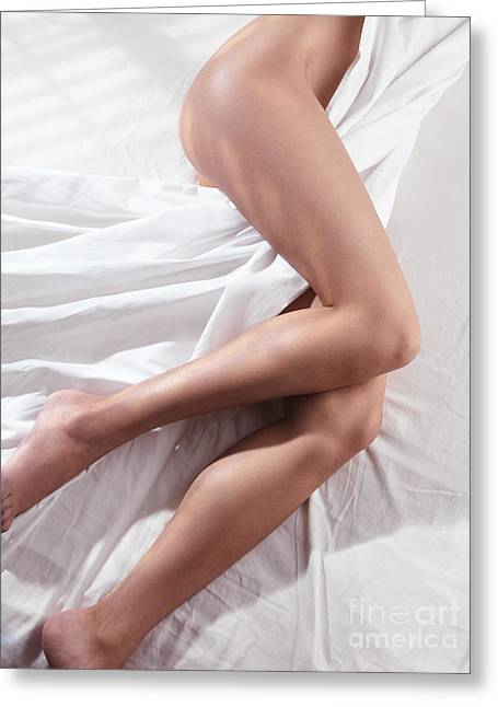 Sexiness Greeting Cards - Bare legs of a young woman sleeping naked in bed Greeting Card by Oleksiy Maksymenko