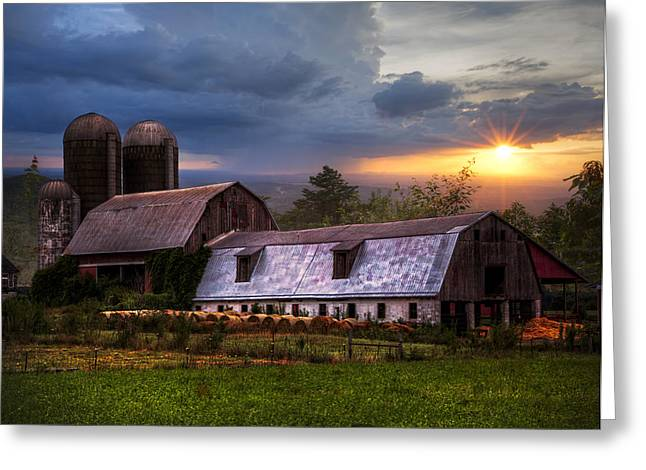 Haybale Photographs Greeting Cards - Barns at Sunset Greeting Card by Debra and Dave Vanderlaan
