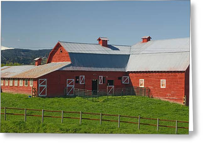 Mountain Greeting Cards - Barns In Field With Mountains Greeting Card by Panoramic Images