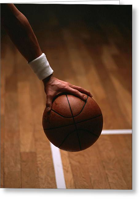 Basket Ball Game Greeting Cards - Basketball ball in male hands Greeting Card by Lanjee Chee