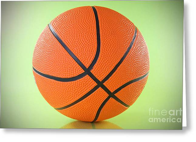 Basket Ball Game Greeting Cards - Basketball Ball Over A Green Background Greeting Card by G J