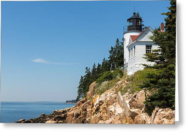 Old Maine Houses Greeting Cards - Bass Harbor Light Station Perched on a Rocky Cliff Greeting Card by John Bailey