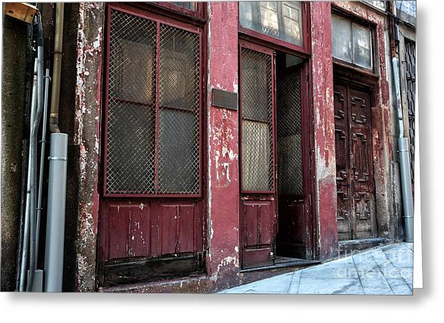 Red Buildings Greeting Cards - Battered Red Greeting Card by John Rizzuto