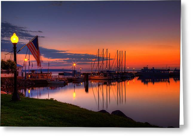 Sailboat Art Greeting Cards - Bayfield Wisconsin Fire in the sky over the harbor Greeting Card by Wayne Moran