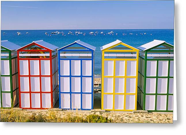 Repetition Greeting Cards - Beach Huts In A Row On The Beach Greeting Card by Panoramic Images