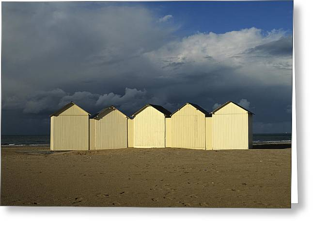 Wooden Building Greeting Cards - Beach huts under a stormy sky in Normandy Greeting Card by Bernard Jaubert