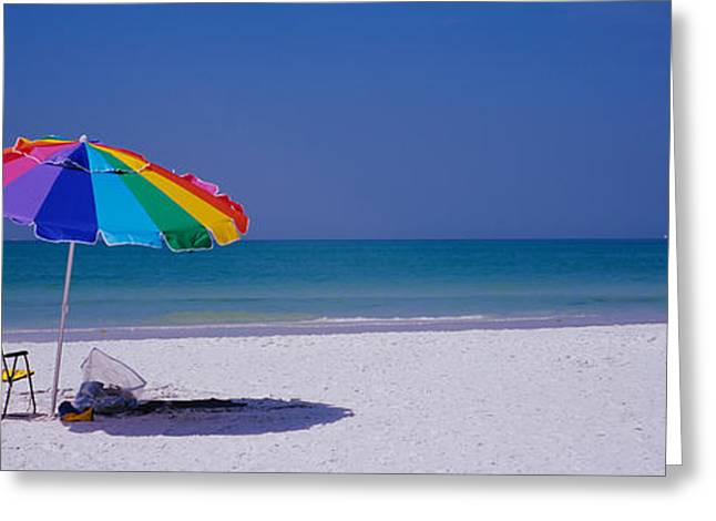 Empty Chairs Greeting Cards - Beach Umbrella And A Folding Chair Greeting Card by Panoramic Images