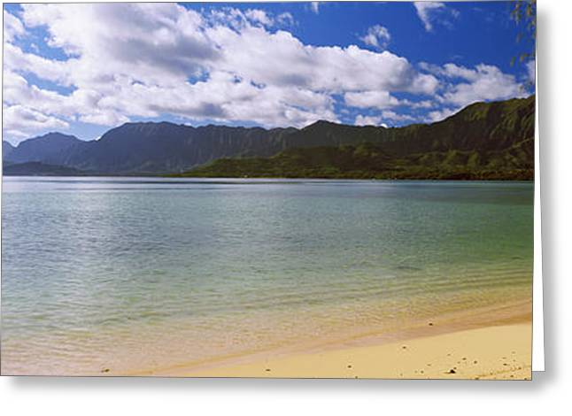 Ocean Photography Greeting Cards - Beach With Mountain Range Greeting Card by Panoramic Images