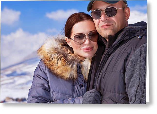 Snowy Day Greeting Cards - Beautiful couple on winter vacation Greeting Card by Anna Omelchenko
