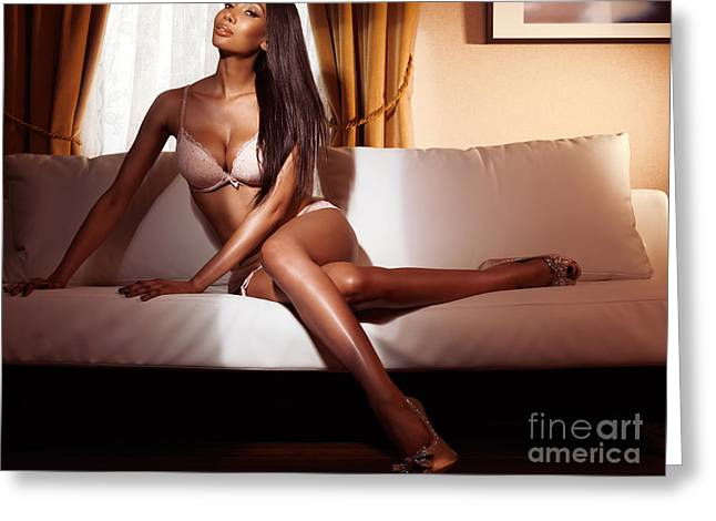 Long Bed Greeting Cards - Beautiful glamorous black woman in lingerie sitting on sofa Greeting Card by Oleksiy Maksymenko