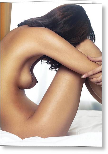 Arm Around Greeting Cards - Beautiful nude woman sitting on bed with arms around her knees Greeting Card by Oleksiy Maksymenko