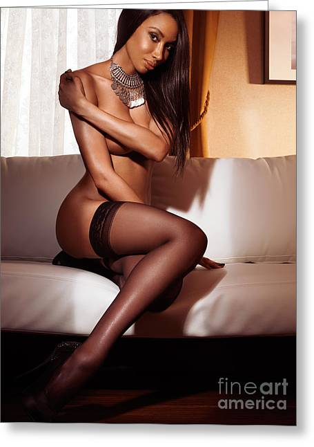 Long Bed Greeting Cards - Beautiful sexy black woman in stockings sitting on sofa Greeting Card by Oleksiy Maksymenko