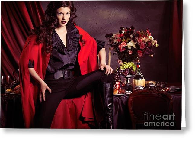 Banquet Greeting Cards - Beautiful woman in red coat in front of festive table Greeting Card by Oleksiy Maksymenko