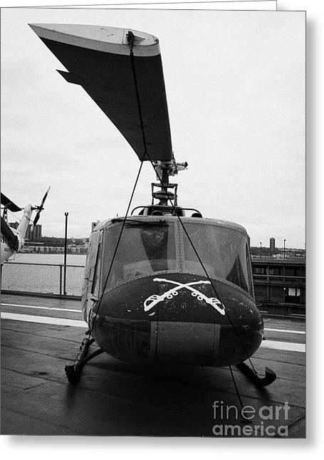 Manhaten Greeting Cards - Bell UH 1A uh1 1 Huey on display on the flight deck at the Intrepid Sea Air Space Museum Greeting Card by Joe Fox