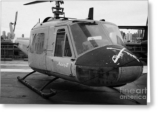 Manhatan Greeting Cards - Bell UH 1A uh1 uh1a Huey on display on the flight deck at the Intrepid Sea Air Space Museum Greeting Card by Joe Fox
