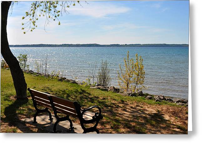 Elk Rapids Greeting Cards - Bench on Grand Traverse Bay Greeting Card by Diane Lent