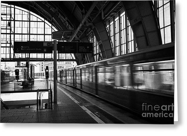 Berlin Germany Greeting Cards - Berlin S-Bahn train speeds past platform at Alexanderplatz main train station Germany Greeting Card by Joe Fox