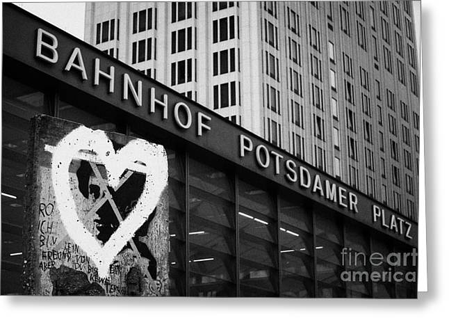 Berlin Germany Greeting Cards - Berlin wall section with heart grafitti outside Potsdamer Platz train station Berlin Germany Greeting Card by Joe Fox