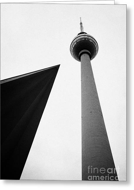 Berliner Greeting Cards - berliner fernsehturm Berlin TV tower symbol of east berlin with the roof of the nearby pavilion Germany Greeting Card by Joe Fox