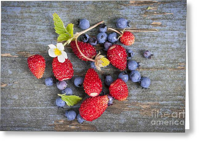 Organic Photographs Greeting Cards - Berries on rustic wood  Greeting Card by Elena Elisseeva