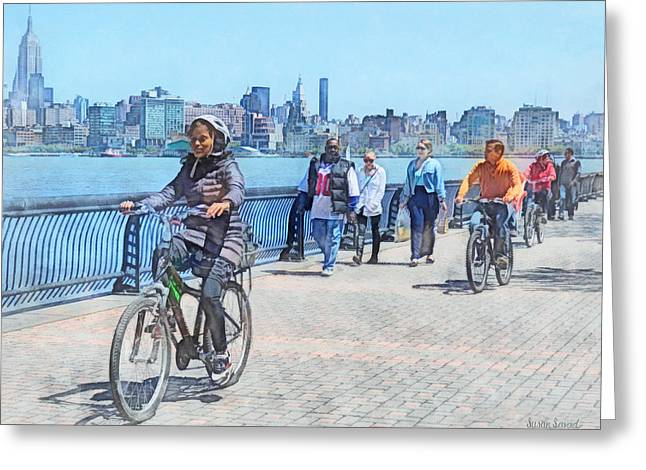 Riding Greeting Cards - Hoboken NJ - Bicycling Along Pier A Greeting Card by Susan Savad
