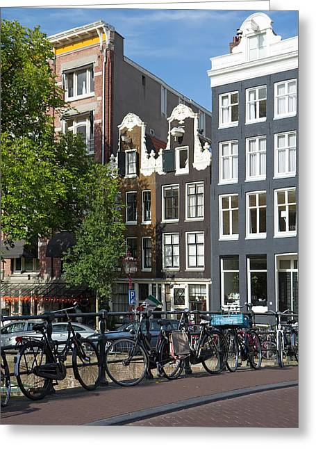 Canal Street Line Greeting Cards - Bicycles on the bridge in Amsterdam Greeting Card by Jaroslav Frank