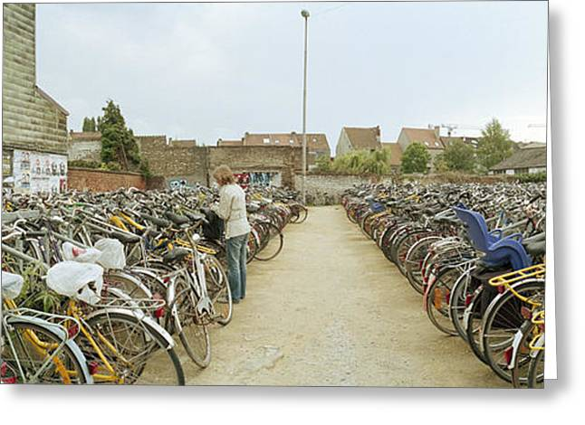 Side By Side Greeting Cards - Bicycles Parked In The Parking Lot Greeting Card by Panoramic Images