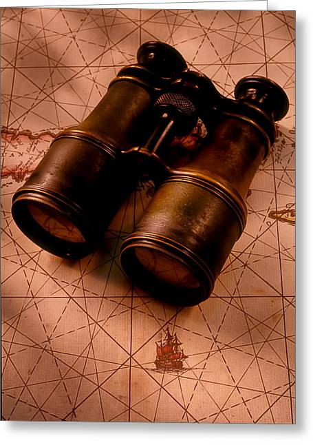 Field Glasses Greeting Cards - Binoculars on old map Greeting Card by Garry Gay