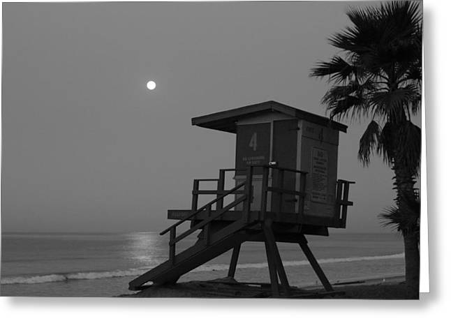 Beach At Night Greeting Cards - Black and White Moon Over  Lifeguard Tower Greeting Card by Richard Cheski