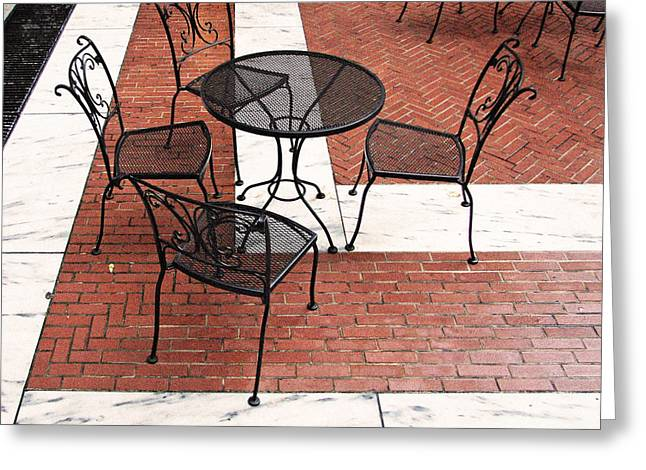 Al Fresco Greeting Cards - Black Cafe Table and Chairs on Marble and Brick Greeting Card by Brooke Ryan