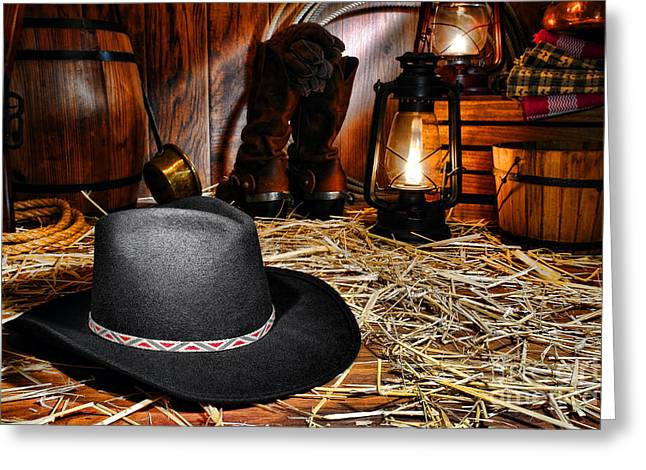 Oil Lamp Greeting Cards - Black Cowboy Hat in an Old Barn Greeting Card by Olivier Le Queinec