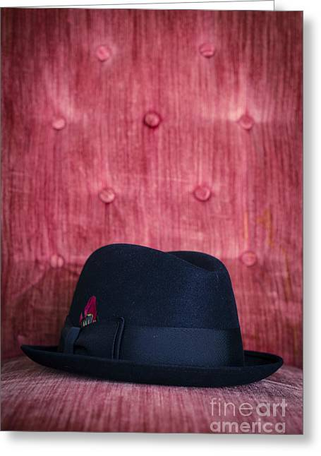 Black Top Greeting Cards - Black hat on red velvet chair Greeting Card by Edward Fielding