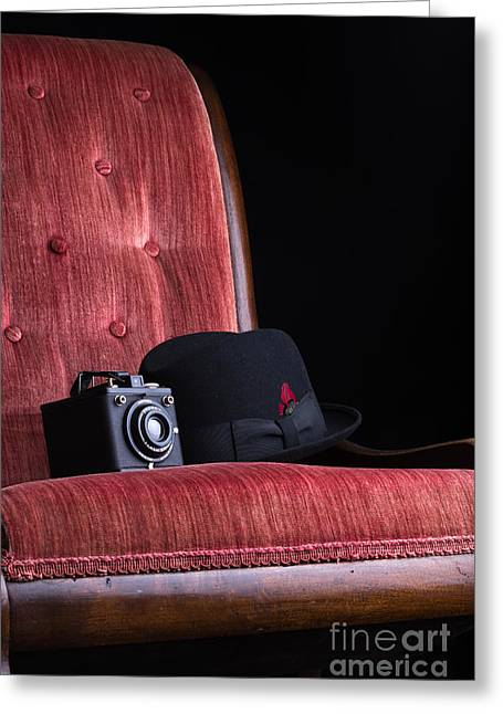 Fedora Greeting Cards - Black hat vintage camera and antique red chair Greeting Card by Edward Fielding