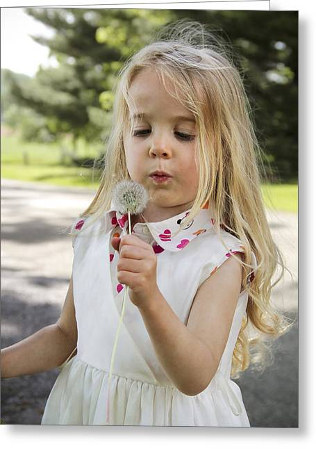 Innocence Greeting Cards - Blowing Dandelions Greeting Card by Emily Olson