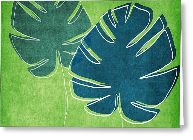 Green Leaves Greeting Cards - Blue and Green Palm Leaves Greeting Card by Linda Woods