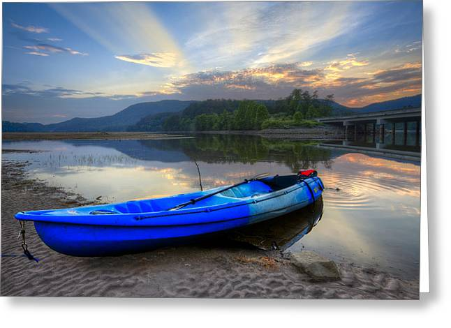 Canoeing Photographs Greeting Cards - Blue Canoe at Sunset Greeting Card by Debra and Dave Vanderlaan