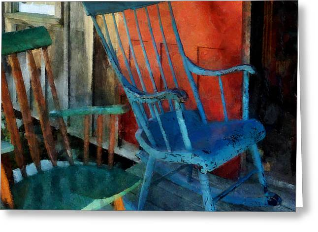 Blue Chair Against Red Door Greeting Card by Susan Savad