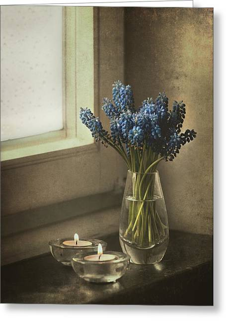 Blue Grapes Greeting Cards - Blue grape hyacinth flowers and lit candles at the window Greeting Card by Jaroslaw Blaminsky