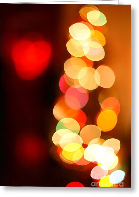 Festivities Greeting Cards - Blurred christmas lights Greeting Card by Gaspar Avila