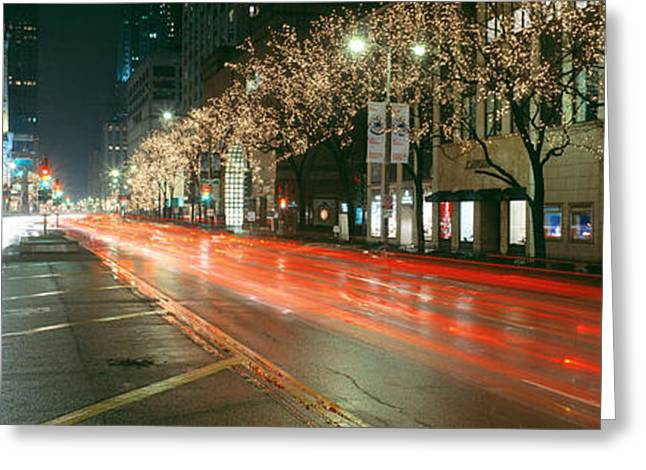 Blurred Motion Of Cars Along Michigan Greeting Card by Panoramic Images
