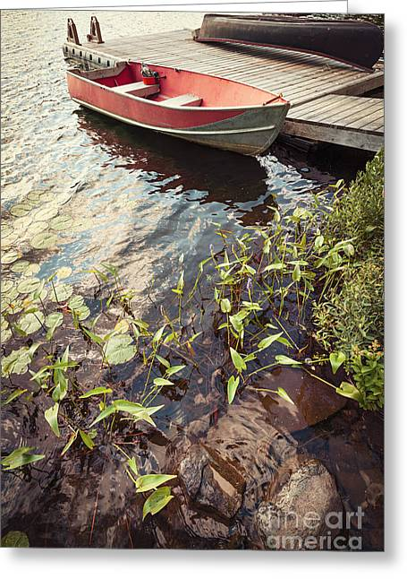 Green Canoe Greeting Cards - Boat at dock  Greeting Card by Elena Elisseeva